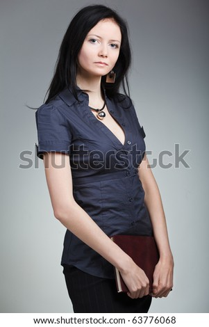 The business woman with book - stock photo