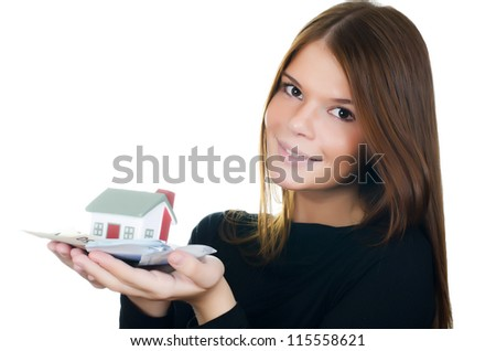The business woman with the toy house and banknotes - stock photo