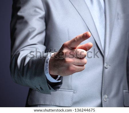 The businessman, a gesture, a finger.