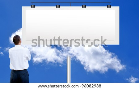 The  businessman against a publicity board and the bright blue cloudy sky - stock photo