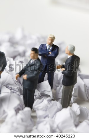 The businessman buried in the form trash. - stock photo