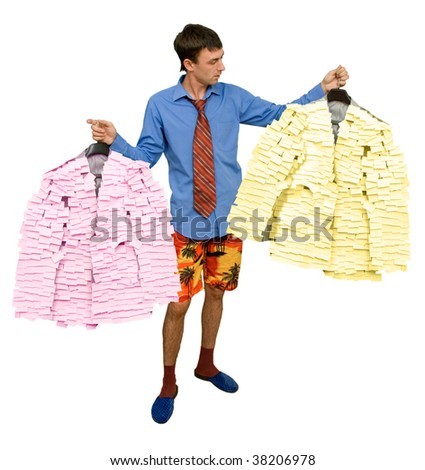 The Businessman chooses the gown before worker daytime. The Costumes of the manager from stickers. - stock photo
