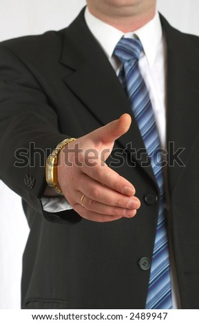 The businessman concludes the transaction, stretches a hand... - stock photo