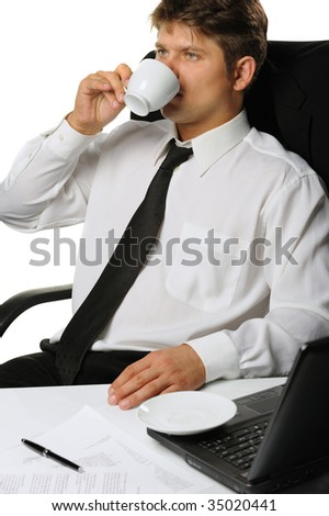 The businessman drinking coffee. It is isolated on a white background - stock photo