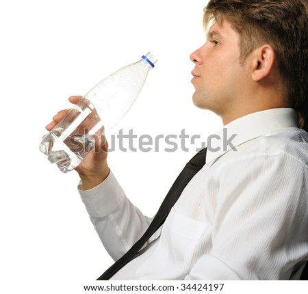 The businessman drinking water from a bottle - stock photo