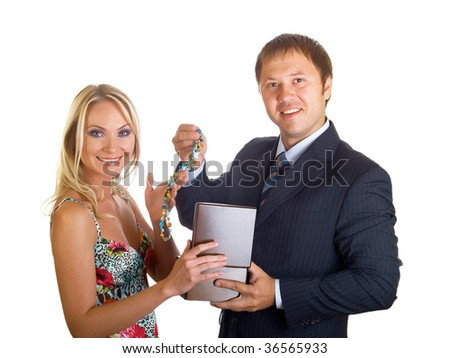 The businessman hands over a gift to the beautiful girl