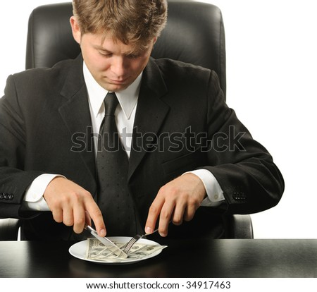 The businessman having dinner dollars - stock photo