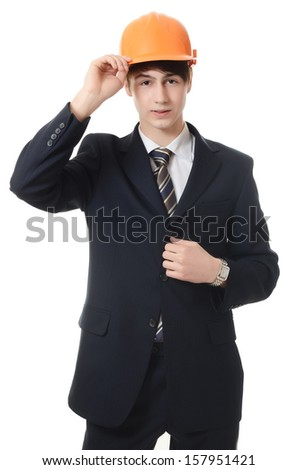 The businessman in a business suit and a building helmet - stock photo