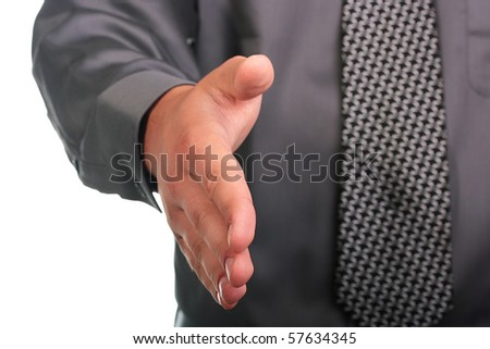 The businessman in a grey shirt and a tie gives a hand for hand shake.