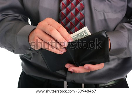 The businessman in a grey shirt and a tie hides money in a purse. - stock photo