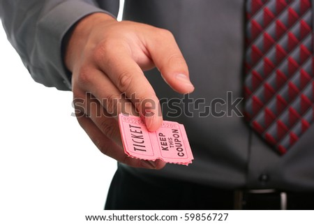 The businessman in a grey shirt and a tie stretches the ticket with the coupon. - stock photo