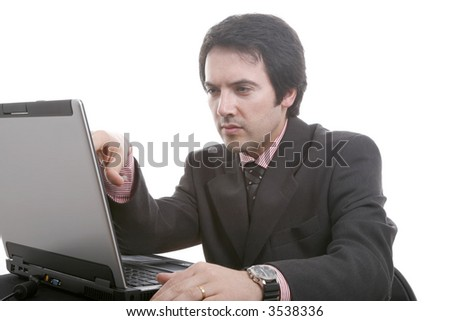The businessman in a suit behind a table, with portable PC... - stock photo