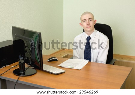 The businessman in a white shirt on a workplace - stock photo