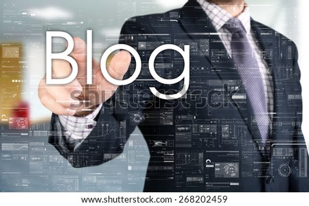 the businessman is choosing Blog from touch screen - stock photo