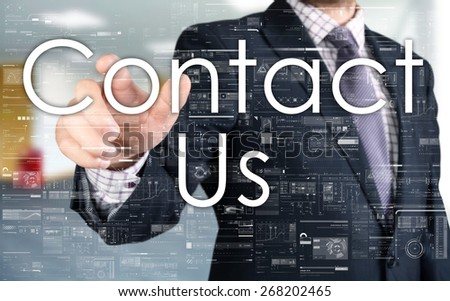 the businessman is choosing Contact Us from touch screen - stock photo
