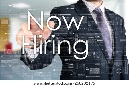 the businessman is choosing Now Hiring from touch screen - stock photo
