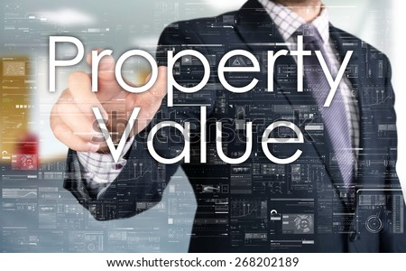 the businessman is choosing Property Value from touch screen - stock photo