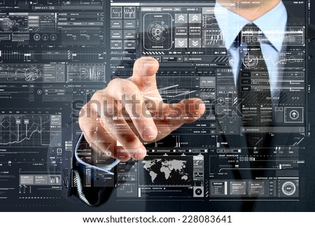 the businessman is choosing something from touch screen