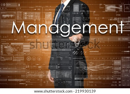 the businessman is presenting the business text with the hand: Management - stock photo