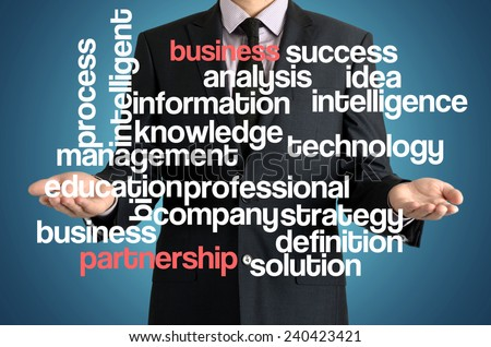 the businessman is presenting the cloud of connected words with: business partnership - stock photo