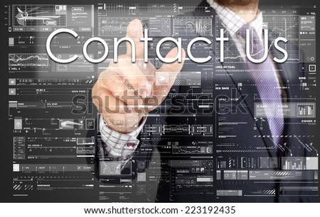 the businessman is pressing the button on the touch screen: Contact Us , business concept describing the modern business - stock photo