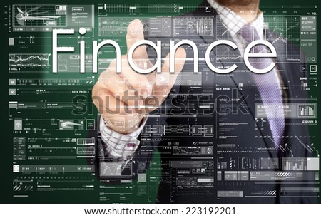 the businessman is pressing the button on the touch screen: Finance , business concept describing the modern business - stock photo