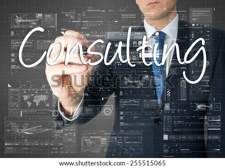 the businessman is writing Consulting on the transparent board with some diagrams and infocharts - stock photo