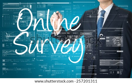 the businessman is writing Online Survey on the transparent board with some diagrams and infocharts with the dark elegant background - stock photo