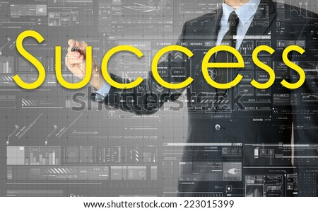the businessman is writing Success on the transparent board with some diagrams and infocharts with the dark elegant background - stock photo