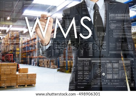 the businessman is writing things connected with the logistics in warehouse. WMS