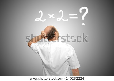 The businessman looks at the formula and thinks