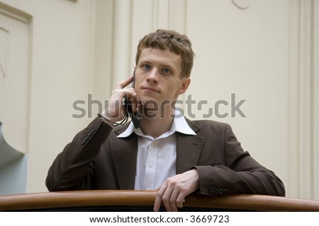 The businessman negotiating on a mobile phone