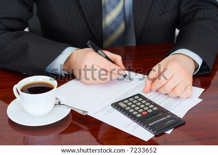 The businessman signs documents - stock photo