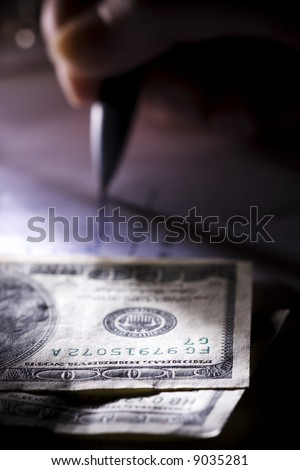 The businessman signs the contract a ball pen