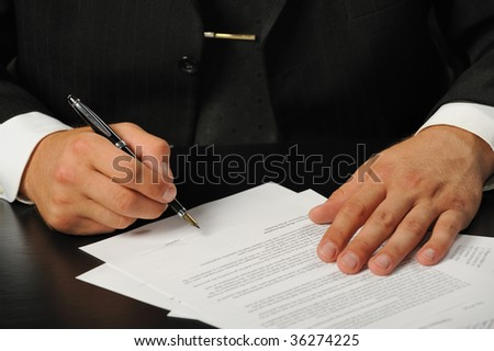The businessman the signing contract.