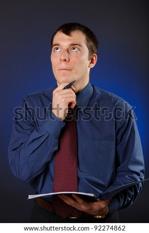 The businessman thought before signing the contract - stock photo
