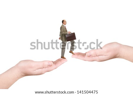The businessman walks on palms, isolated over a white background - stock photo
