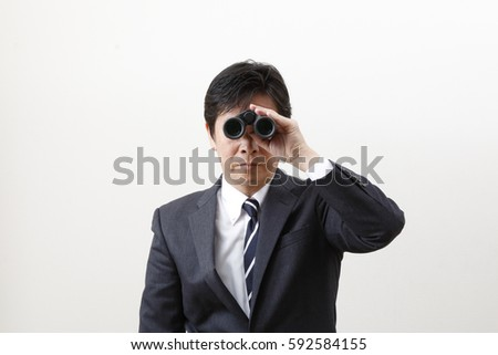 The businessman who looks in binoculars