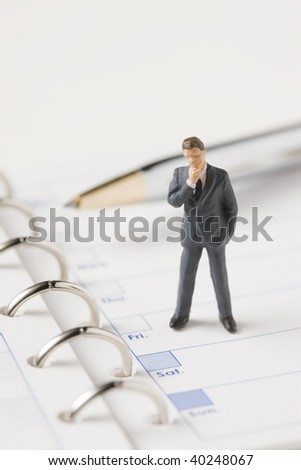 The businessman who thinks on the binder note.