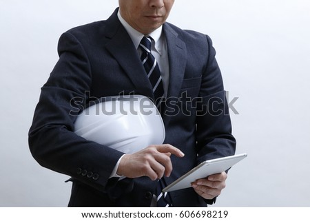 The businessman who uses the tablet terminal on the site