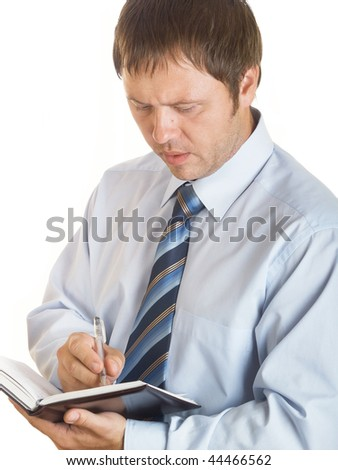 The businessman with a  notebook on the white background