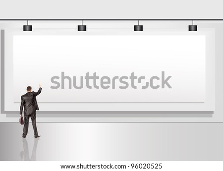 The businessman with a portfolio against an advertising billboard - stock photo