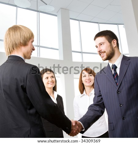 The businessmen welcoming each other at office - stock photo