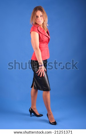 The businesswoman on the blue backgroud - stock photo