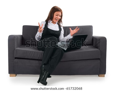 The businesswoman very emotionally works at the computer. The woman has received the letter with the excellent maintenance. - stock photo