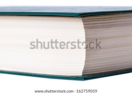 the butt of the old closed the book on a white background closeup