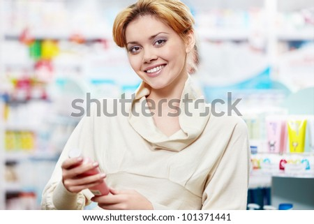 The buyer at the pharmacy - stock photo