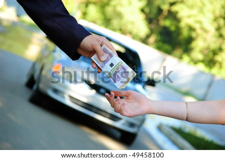 The buyer transfers a pack of money for the car