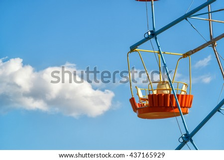 The cabin Ferris wheel on a background of blue sky with cloud. - stock photo