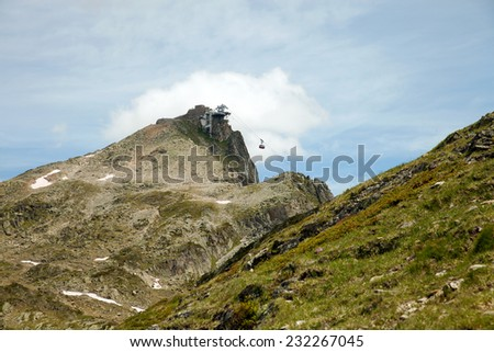 The cable car station on top of mountain in european alps - stock photo